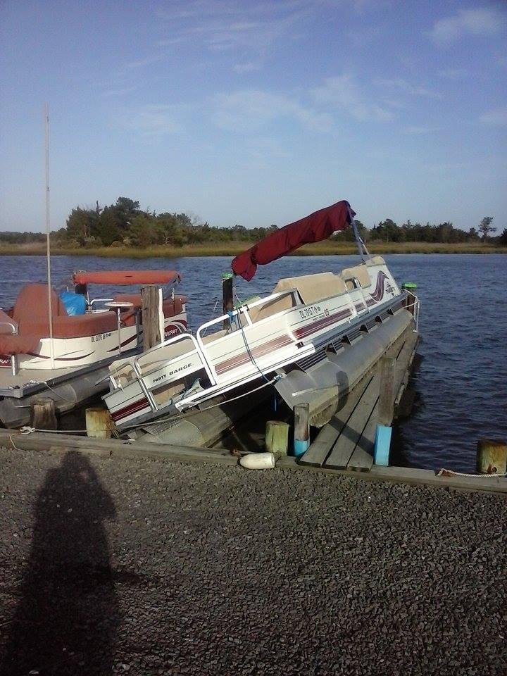 pontoon on dock, storm surge boat damage, delaware, sussex county, white house beach, long neck, check your boats
