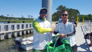 Michael Duncan from Helly Hansen presenting first prize to Jim Toogood (left)