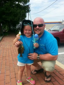 The Cookus Dad and daughter fishing team score a fish .. photo by Dexter Long