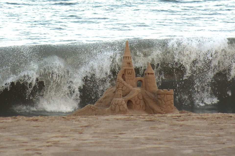 Image result for images of sandcastle hit by water